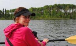 Elizabeth O'Brien paddling a kayak